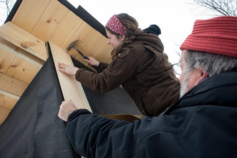 Tara & Charlie Putting Siding on the Solar Shed