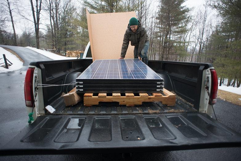 Tyler Unloading Brand New Solar Panels!