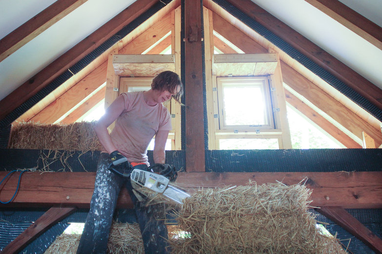 Natasha Chainsawing Bale (by Pete)