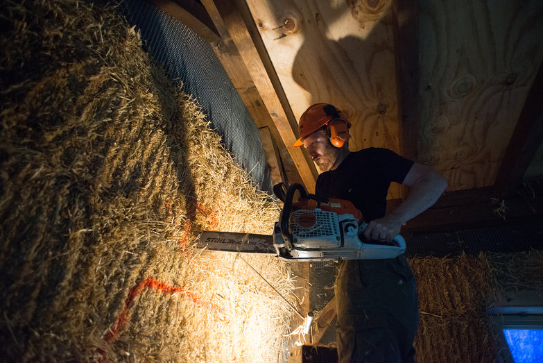 Tyler Cutting Hole in Strawbale Wall w/ Chainsaw