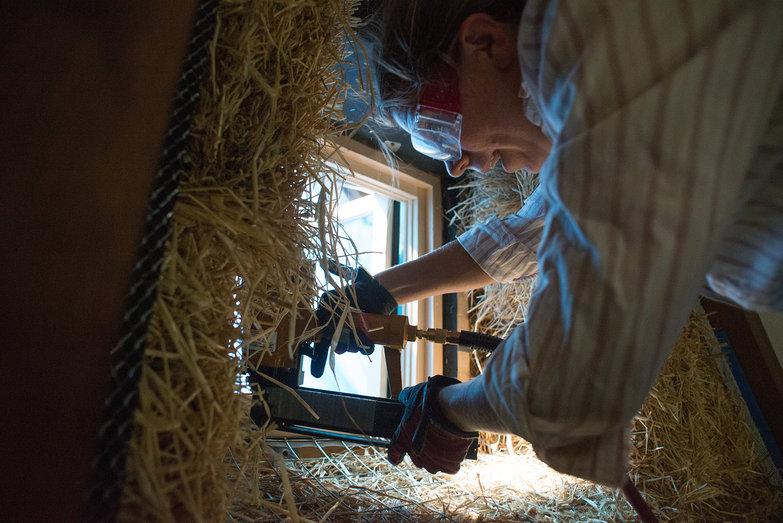 Joanna Stapling Wire Mesh on Window Framing