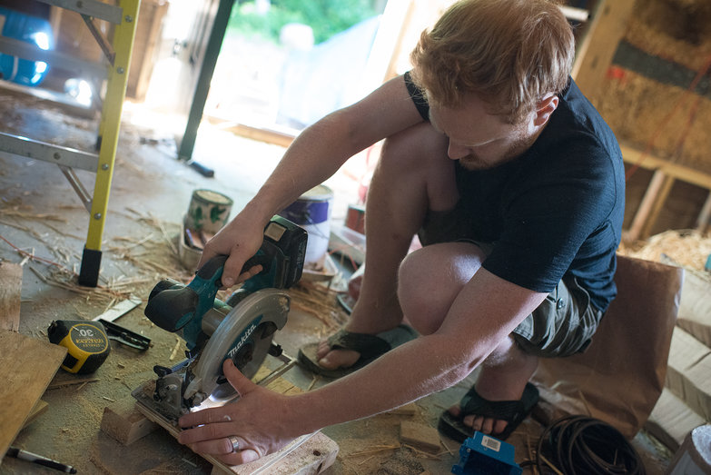 Tyler Cutting Out Electrical Plates for Straw Bale Building