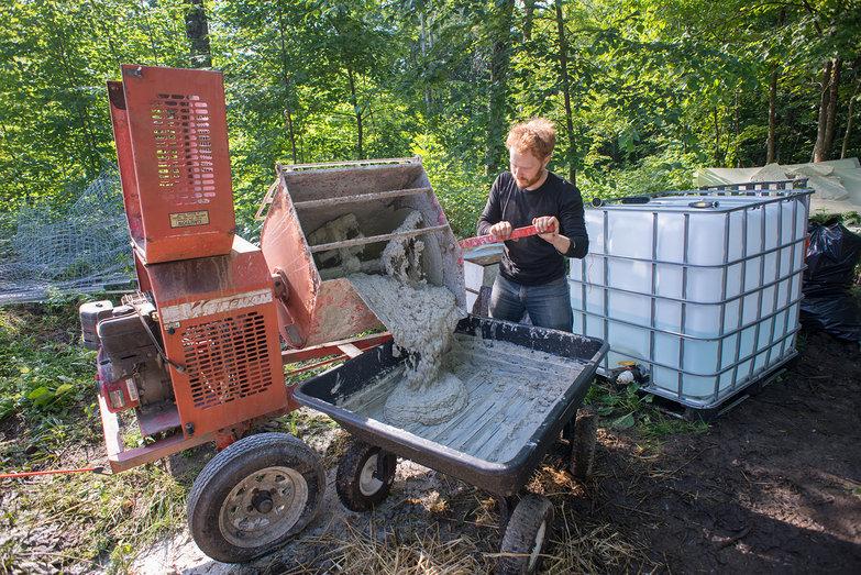 Tyler Dumping Plaster into Garden Cart