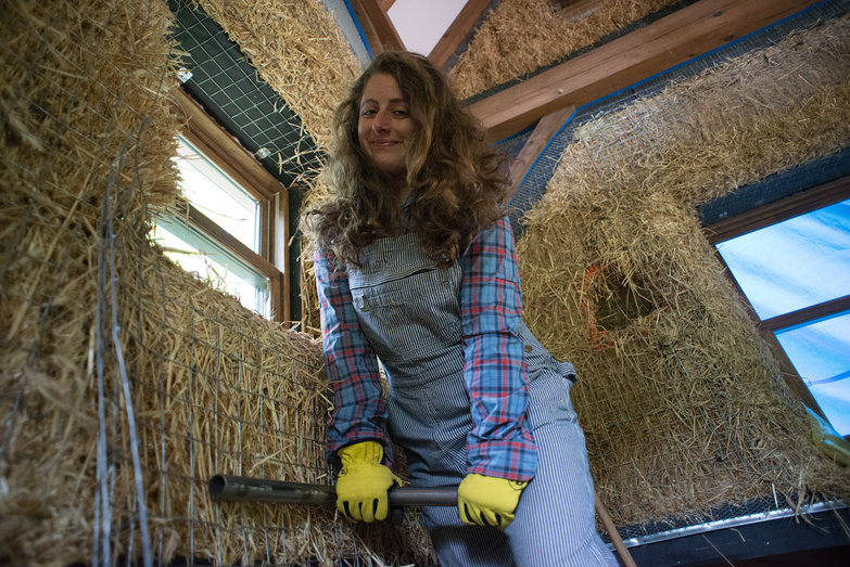 Tara Stretching Wire Mesh Over Straw Bale