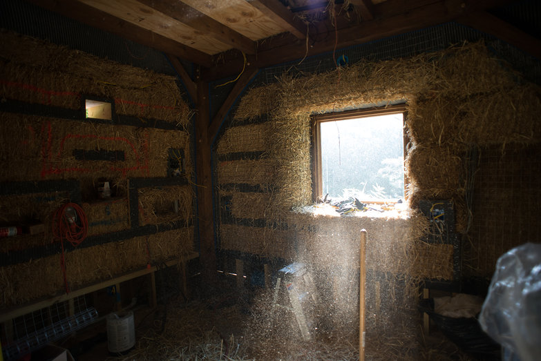 Loose Straw Falling in Straw Bale Cottage