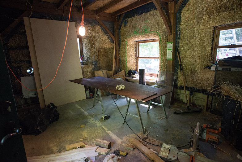 Staining Plywood in Messy Strawbale House Work Site