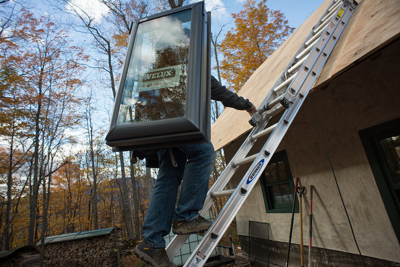 Donavin Carrying Skylight to Roof