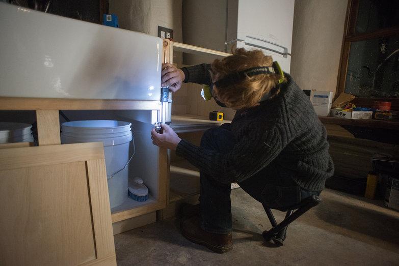 Tyler Measuring Kitchen Cabinet for Door Hinge Placement