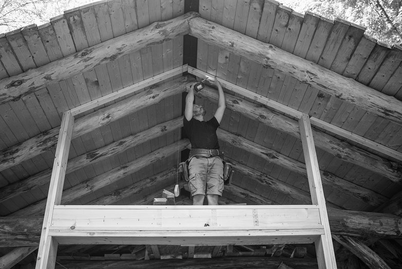 Tyler Affixing 2x4s to Roof Decking