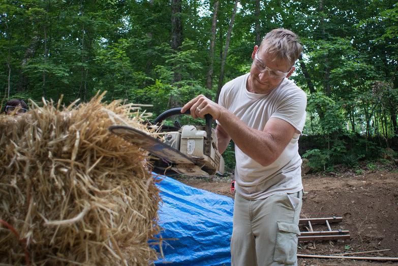Josh Notching Strawbale w/ Chainsaw