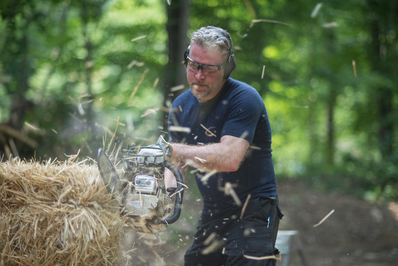 David Notching Strawbale w/ Chainsaw