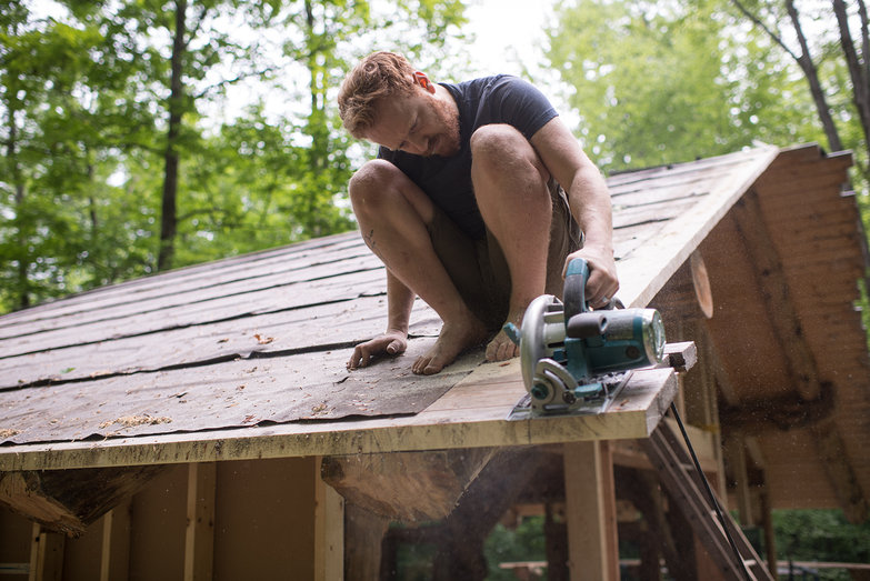 Tyler Sawing Roof Decking