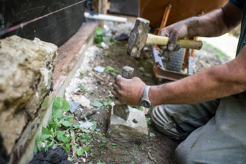 Pete the Mason Chiseling Stone