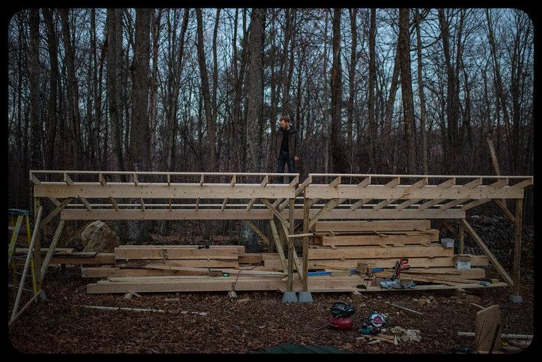 Tyler on Woodshed Roof at Dusk