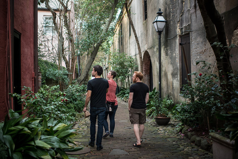 Seth, Lucy & Tyler Walking Through Charleston Alleyway