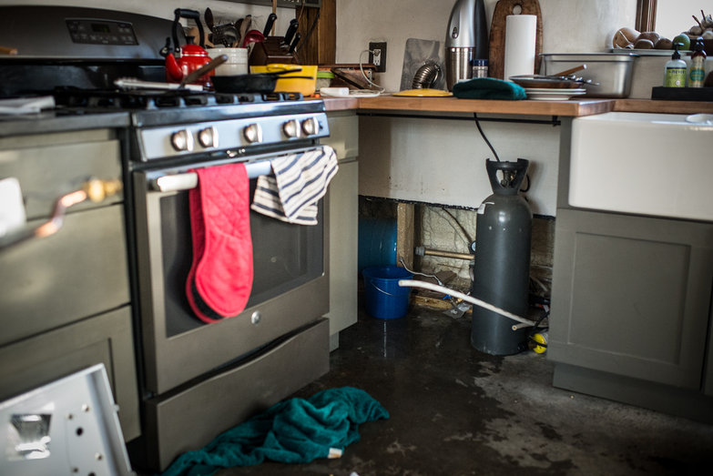 Kitchen Puddle from Burst Water Heater Pipe