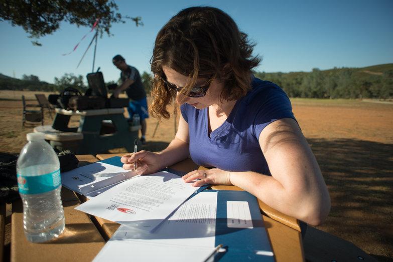 Tara Signing Powered Paragliding Waivers