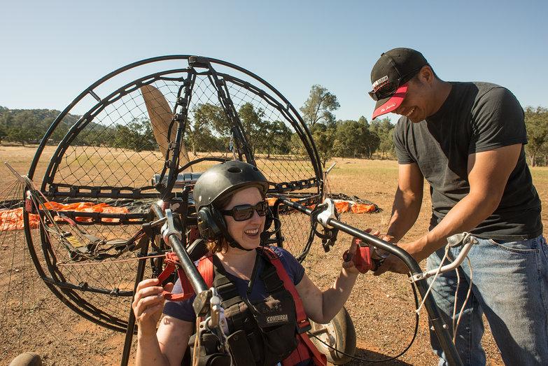 Joe Helping Tara Get Ready to Taxi in LowBoy II Quad Paramotor