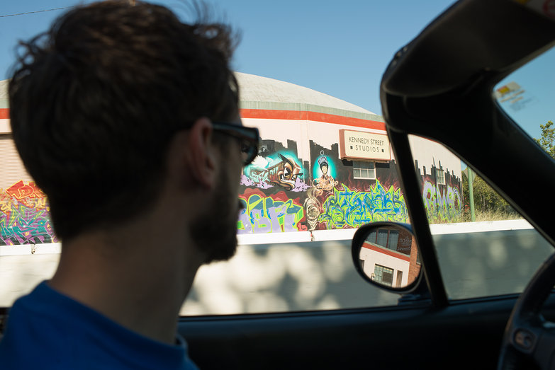 Lian Driving Miata Looking at Graffiti