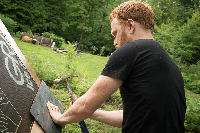 Tyler Affixing Starter Slate to Strawbale Cottage Roof