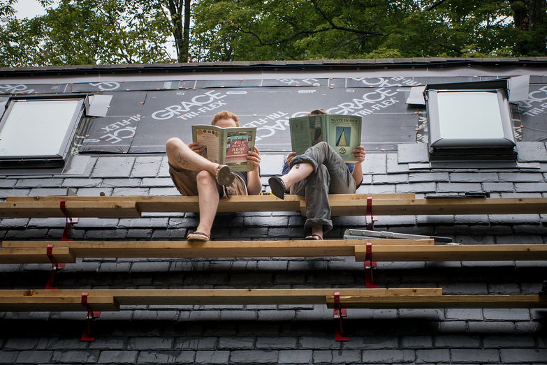 Us Reading Slating Books on Slate Roof of Straw Bale Cottage