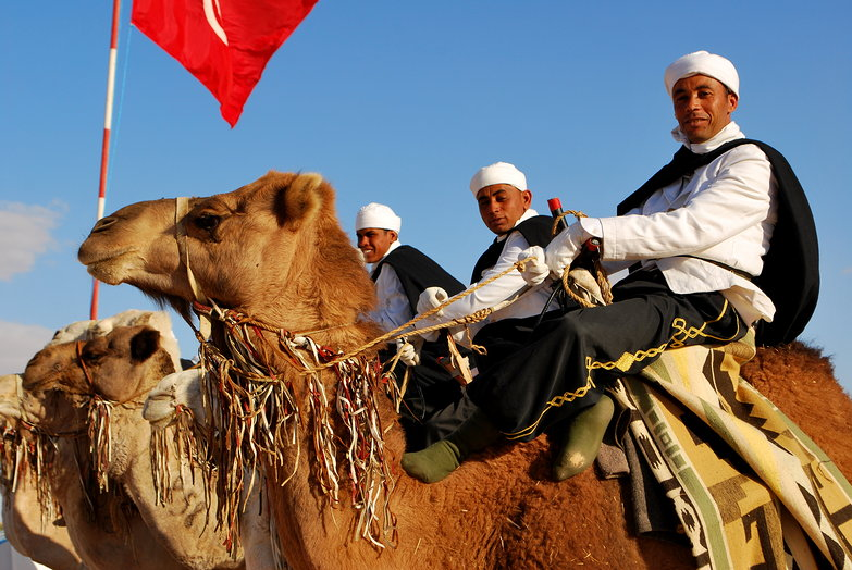 Smiling Camel Riders