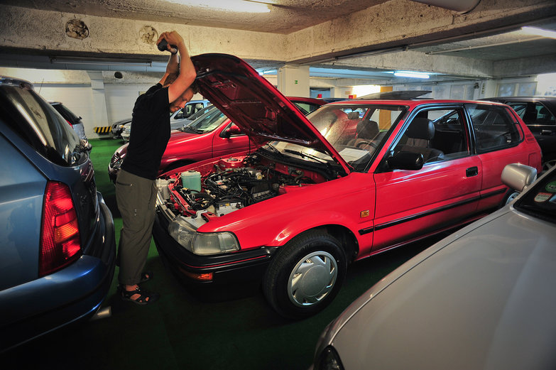 Tyler Inspecting a Car