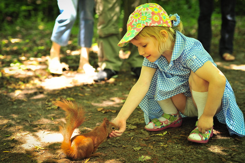 Polish Girl Feeding Squirrel