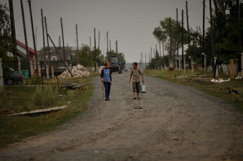 Siberian Boys Walking to the Well