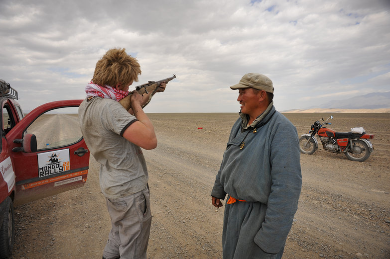 Charlie Aiming Mongolian Man's Gun