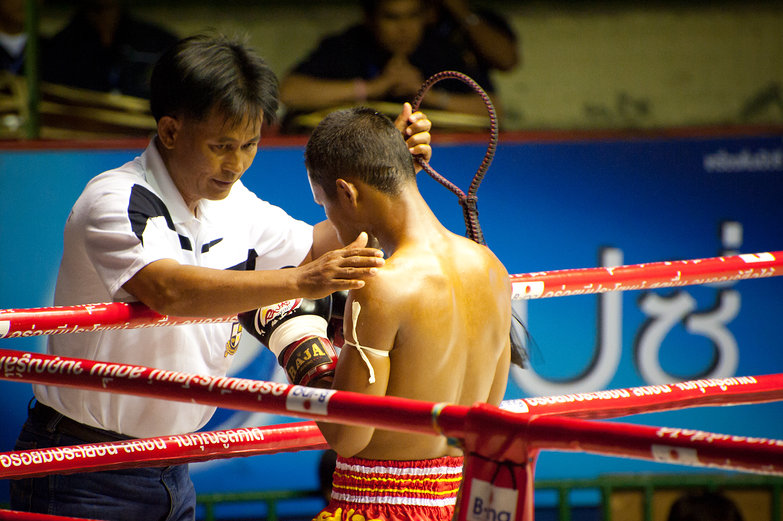 Muay Thai Trainer Removing Mongkhon Headband