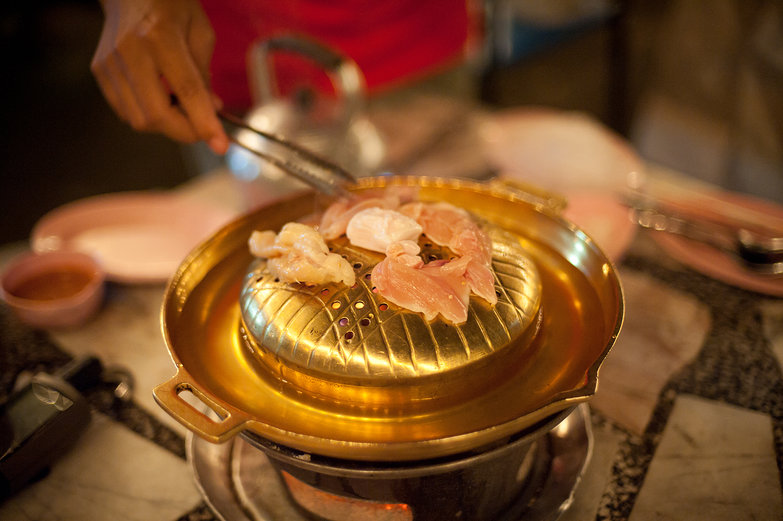 Cooking Chicken at Thai Buffet