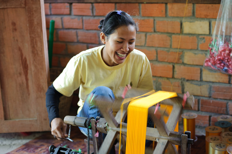 Laughing Cambodian Woman Winding Silk