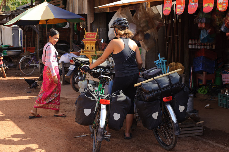 Tara & Our Bikes in Little Cambodian Village