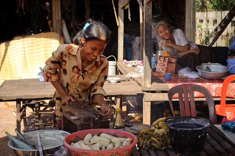 Cambodian Woman Squishing Bananas