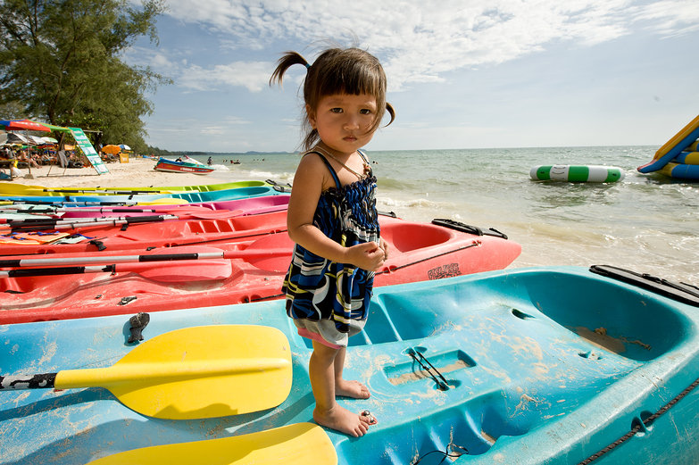 Little Cambodian Girl on Colorful Boats