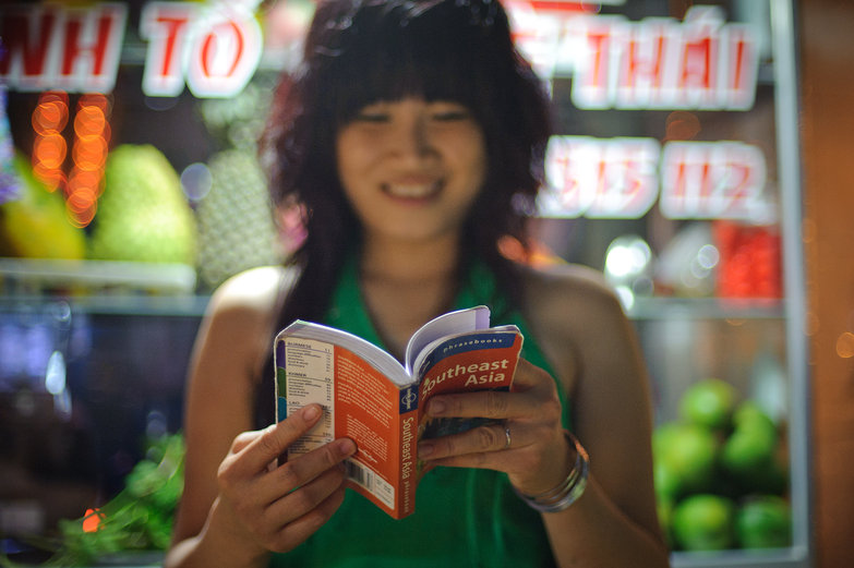 Vietnamese Girl Reading our Phrasebook