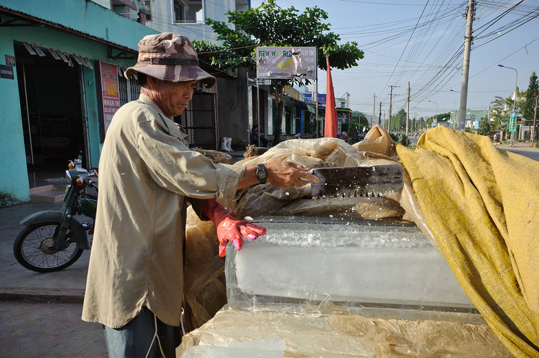 Vietnamese Man Sawing Ice