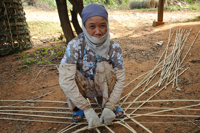 Vietnamese Woman Weaving Bamboo Basket