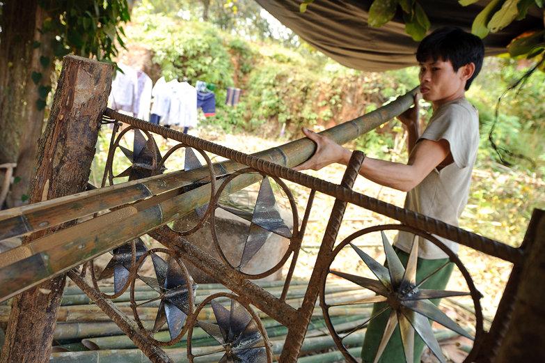 Vietnamese Man Splitting Bamboo