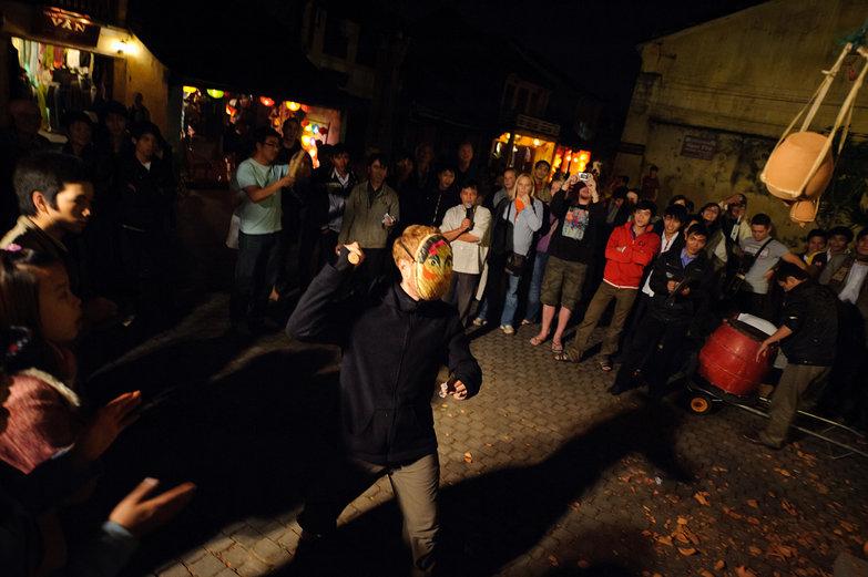 Tyler Playing Hội An Lantern Festival Pottery Smashing Game