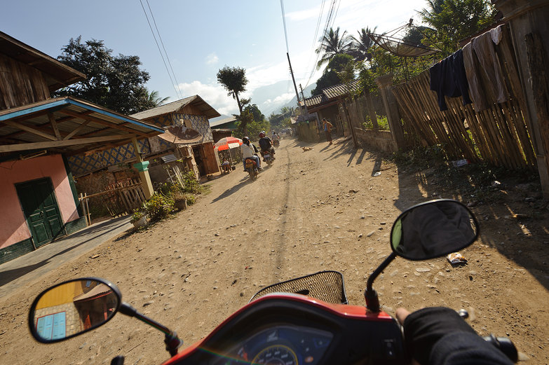 Riding Through Lao Village