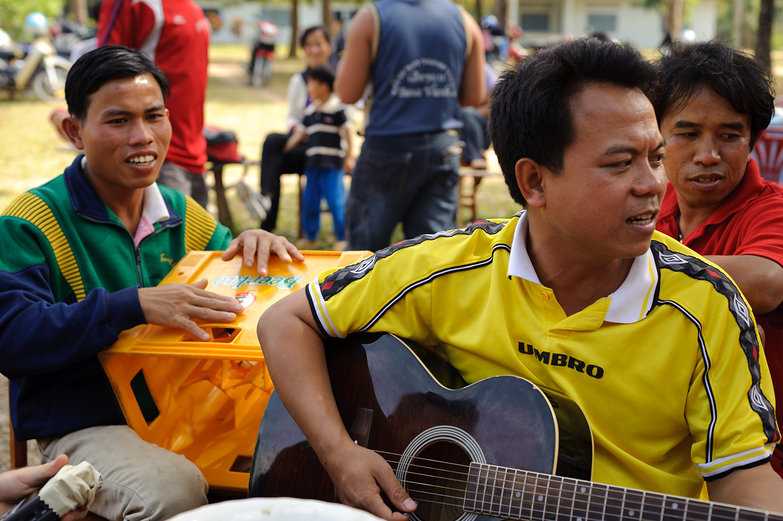 Lao Men Making Music