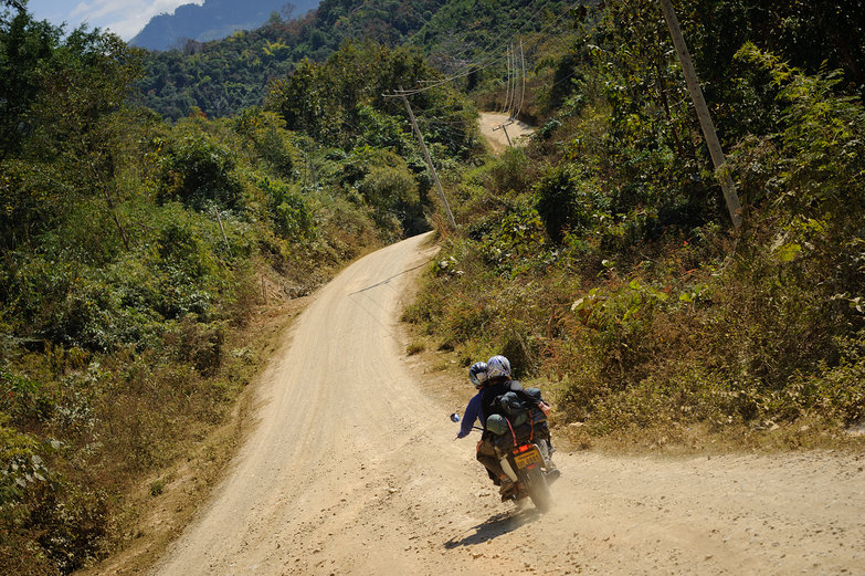 Motorcycling on Lao Dirt Road