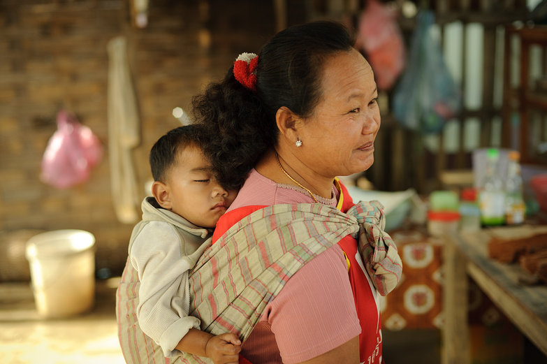 Lao Grandma Carrying Baby