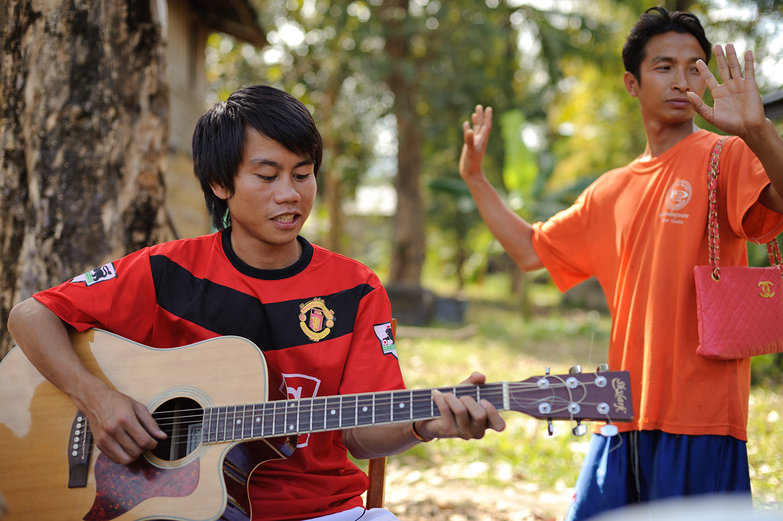Lao Men Making Music & Dancing
