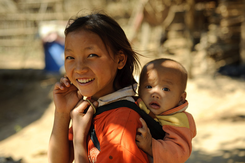 Lao Girl Carrying Baby