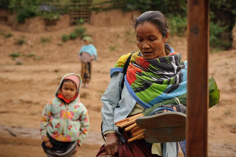 Lao Woman & Child Boarding Boat