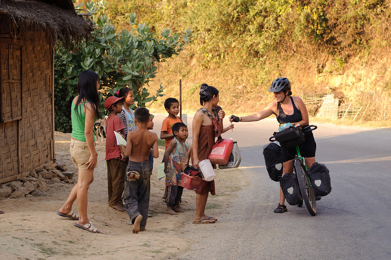 Tara Giving Pencils to Lao Kids