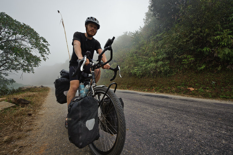 Tyler Cycling Up Misty Lao Mountain
